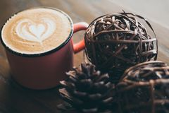 Pine cone and latte low light royalty free stock image