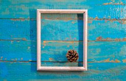 pine cone lies in a white empty frame royalty free stock photo