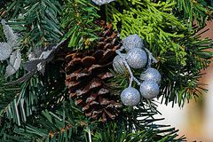 Pine cone. An pinecone on a wreath with decorations Stock Photography