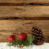 Pine cone and red baubles Royalty Free Stock Images