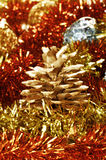 Pine cone and tinsel Royalty Free Stock Photos