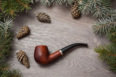 Pine cone tree snow macro tobacco pipe. Holiday Royalty Free Stock Images
