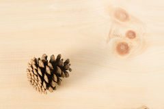 Pine Cone on Wood Royalty Free Stock Images
