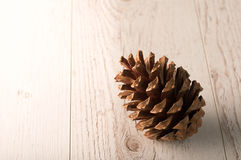 Pine cone on a wooden background Royalty Free Stock Photos