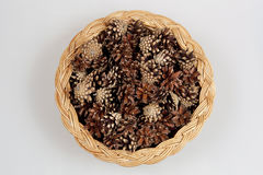 Pine cones in a basket. Royalty Free Stock Photos
