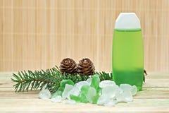 Pine cones and bath salts. Royalty Free Stock Photos