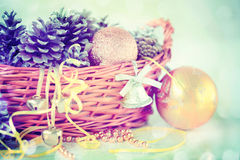 Pine Cones, Bells and Christmas Balls in the Basket Royalty Free Stock Photo