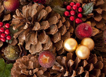 Pine cones, berries, and baubles Stock Image