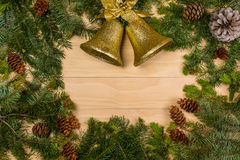 Pine cones and branches with christmas bells royalty free stock photography