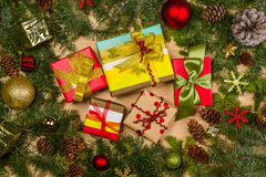 Pine cones and branches with christmas present boxes stock images