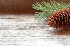 Pine cones and branches on wooden background Christmas background Copy space selective focus. Pine cones and branches on wooden background Christmas background Royalty Free Stock Image