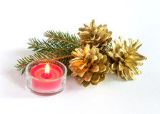 Pine cones and candle Royalty Free Stock Photography