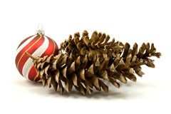 Pine cones and christmas bauble Stock Photo