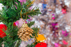 Pine cones and christmas decorations on christmas tree. Royalty Free Stock Photo