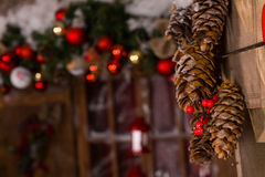 Pine Cones Christmas Decors Hanging on Wall Royalty Free Stock Photo