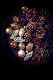 Pine cones and Christmas ornaments on a rustic tray Stock Photography