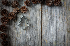 Pine Cones and Christmas Tree on a Rustic Wood Stock Photography