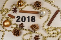 2018, pine cones, cinnamon sticks, star anise, baubles and pearl Stock Images