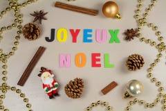Pine cones, cinnamon sticks, star anise, pearl tinsel, Santa Cla Royalty Free Stock Photos