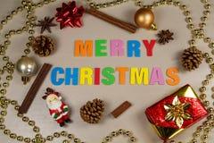 Pine cones, cinnamon sticks, star anise, pearl tinsel, Santa Cla Royalty Free Stock Photo