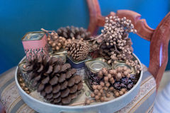 Pine cones decoration. Pine cone decoration on a plate Stock Image