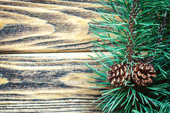 Pine cones and fir branches in rustic style on old wooden background. Christmas concept with copy space for text. Top view close-up Stock Image