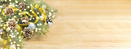 Pine cones and fir tree with Christmas lights Royalty Free Stock Image