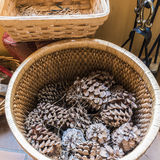 Pine cones by the fireplace in a mountain hotel Royalty Free Stock Photos