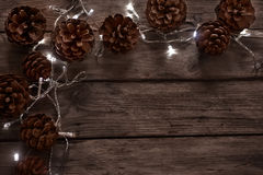 Pine cones and garland background Royalty Free Stock Photo