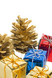 Pine cones and gifts Stock Image