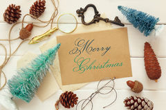 pine cones, greeting card, christmas tree and vintage objects royalty free stock image