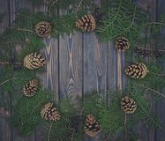 Pine cones and old wood. Christmas card in rustic style Royalty Free Stock Photography