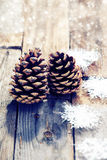 Pine cones on old wooden background Stock Image