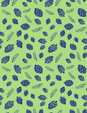 Pine cones and pine branches on a green background seamless vector pattern Stock Photo