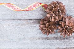 Pine Cones and red ribbon Royalty Free Stock Photo