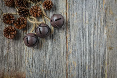 Pine cones and Rustic Bells Royalty Free Stock Photography