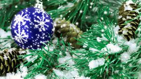 Pine with cones, a toy and a snowfall stock video footage