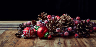 Pine cones and vintage Christmas ornaments Royalty Free Stock Image