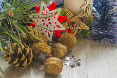 Pine cones with walnuts and candle. With christmas decoration on wooden table. Copyspace background royalty free stock photos