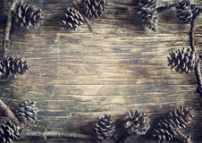 Pine cones. Pine cones on wooden background Royalty Free Stock Image