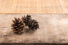 Pine cones on wooden background Stock Photography