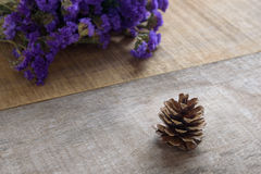 Pine cones on wooden background Royalty Free Stock Images