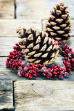 Pine cones on  wooden background Stock Photos