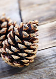 Pine cones on wooden background Royalty Free Stock Photography