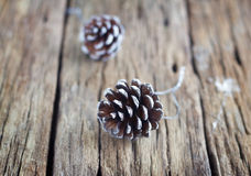 Pine cones on wooden table background Stock Photography