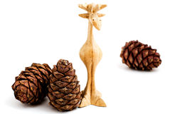 Pine cones and wooden toy moose. On a white background Royalty Free Stock Photos