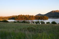 Pine covered peninsula on Lake Cuyamaca. Lake Cuyamaca, San Diego County, California Royalty Free Stock Photos