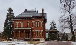 Pine Craig. This is a winter icture off Pine Craig also known as the Martin-Mitchel Mansion located at the Naper Settlement in Naperville, Illinois. The house royalty free stock photos