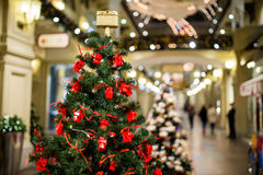 Pine decorated with celebratory toys. Christmas pine decorated with celebratory toys in mall Royalty Free Stock Images