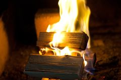 Pine firewood burning at fireplace Royalty Free Stock Images